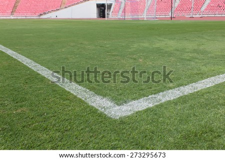 The corner on green lawn of soccer field - stock photo