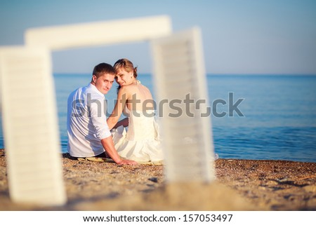 the couple at the sea. rest - stock photo
