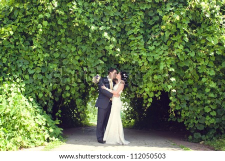 the couple dancing in the park - stock photo