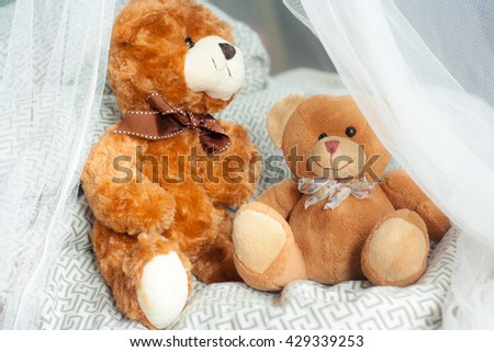 The couple of Teddy Bear sitting on bed around by mosquito net. / Teddy bear - stock photo