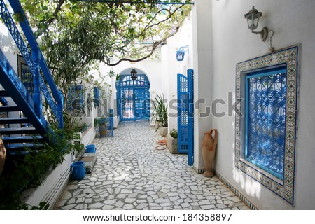 The courtyard of a typical house in Sidi Bou Said,Tunisia. Sidi Bou Said is a town in northern Tunisia known for the use of blue and white in it's architecture. - stock photo