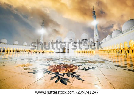 The courtyard of Sheikh Zayed Grand Mosque in Abu Dhabi at sunset - stock photo