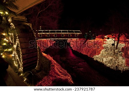 The covered bridge at Clifton Mill in central Ohio is decorated for the holidays. - stock photo