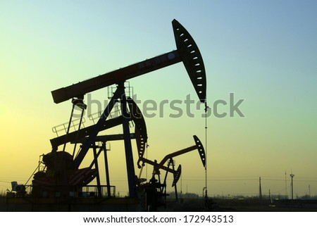 The crank balanced beam pumping unit in the JiDong oilfield, on December 1, 2013, caofeidian, hebei province, China.   - stock photo