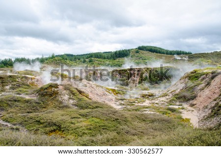 The Craters of the Moon is a geothermal walk located just north of Taupo. The walk features mud craters, steaming with geothermal activity. - stock photo