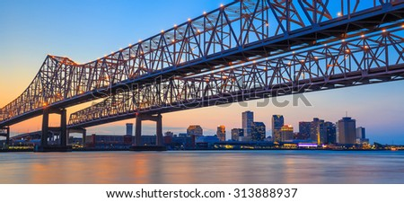 The Crescent City Connection Bridge on the Mississippi river and downtown New Orleans Louisiana - stock photo