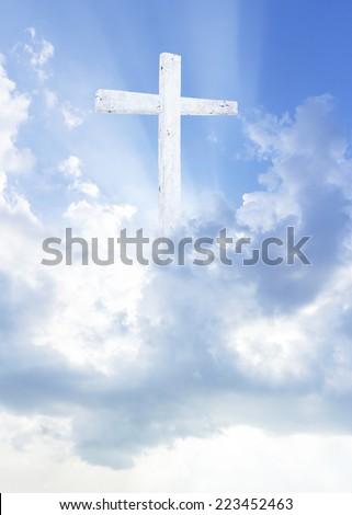 The cross and amazing light. - stock photo