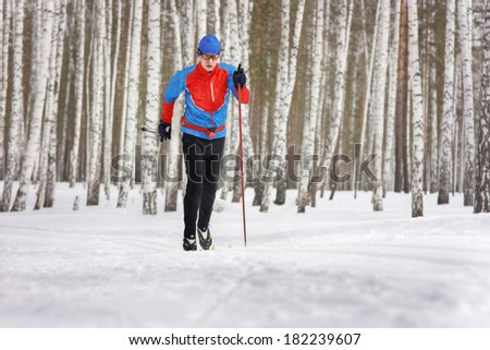The Cross-country Skier in winter forest - stock photo