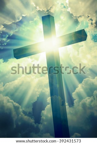 The cross on bright sun and clouds background - stock photo