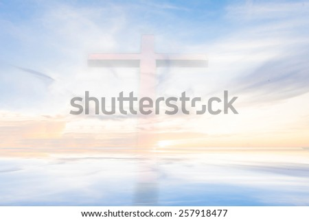 the cross with ray of sunlight glow behind the cloud on the sky background - stock photo