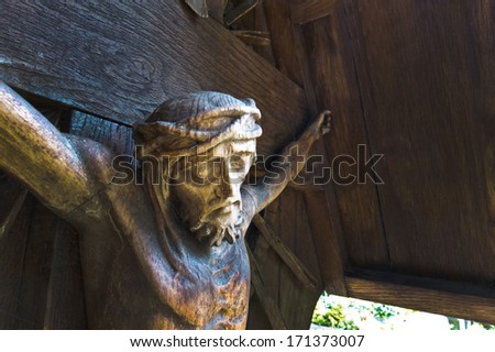 the crucifixion of jesus christ on the cross from a tomb - stock photo