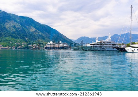 The cruise liner departures from the port of Kotor, Montenegro. - stock photo