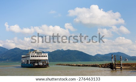 The cruise white liner sailing on the sea and blue sky. - stock photo