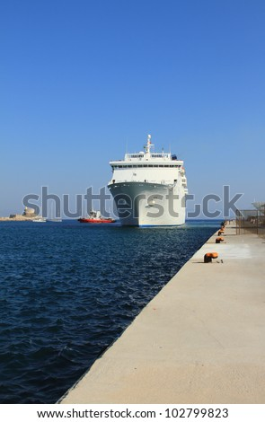The cruising liner arriving to port. Rhodes, Greece - stock photo