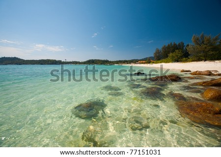 The crystal clear transparent water and rocks on perfect paradise island of Koh Lipe (aka Ko Lipeh), Thailand.  Horizontal - stock photo