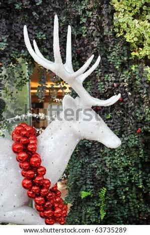 the crystal reindeer wearing christmas balls on the celebration season - stock photo