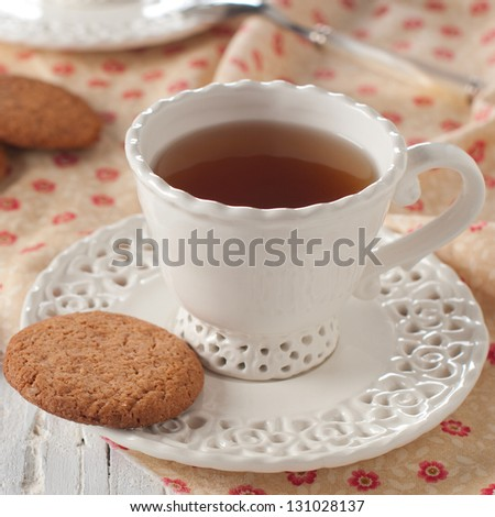 The cup of tea and oatmeal cookie - stock photo
