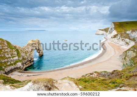 The curved bay at Durdle Door on the Jurassic Coast in Dorset, UK. - stock photo