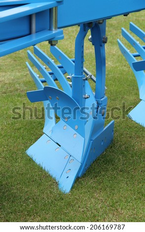The Cutting Blade of an Agricultural Farming Plough. - stock photo