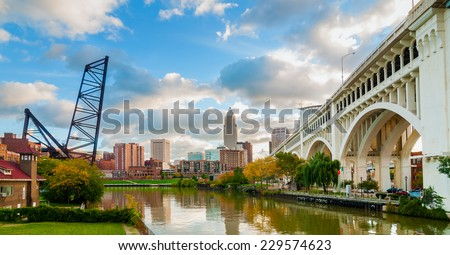 The Cuyahoga River bends past downtown Cleveland by the Veterans Memorial Bridge with old lift bridge at left - stock photo