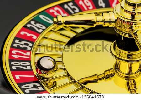 the cylinder of a roulette gambling in a casino. profit and loss is decided by chance. - stock photo