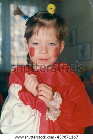 THE CZECHOSLOVAK SOCIALIST REPUBLIC - CIRCA 1980s:  Retro photo shows small girl wears funny costum. Vintage color photography. - stock photo