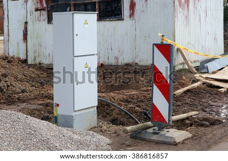 The dangerous dirty zone on construction of the rural house is fenced with violations of safety measures - stock photo
