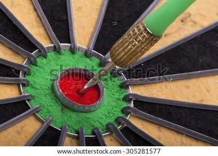 the dart hit the target on dartboard - stock photo