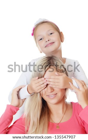 The daughter closes to mum of eye hands - stock photo