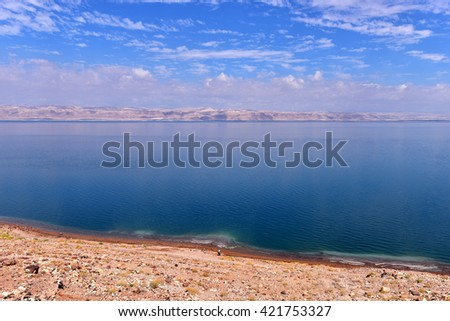 The Dead Sea also called the Salt Sea, is a salt lake bordered by Jordan to the east and Israel and the West Bank to the west - stock photo