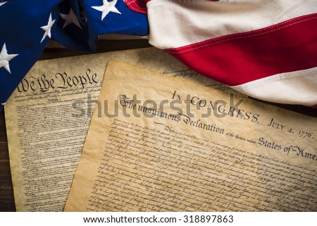 The Declaration of Independence and Constitution of the United States of America with a vintage flag - stock photo