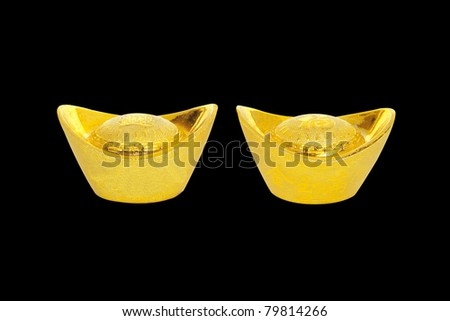 The decoration of gold bullion to China in a black background. - stock photo