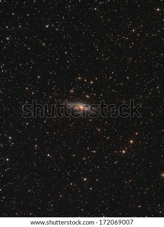 The Deerlick Galaxy Group: This is a group of galaxies about 40 million light years away in the constellation Pegasus. It is dominated by NGC7331, the largest member of the group. - stock photo