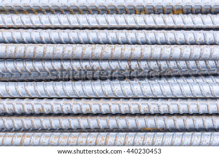 The deform bar, the steel deform bar pile on the construction site. Close-up the corrosion on the steel deform bar which cause of rust. - stock photo