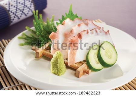 The delicious squid sashimi on the white plate. - stock photo
