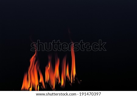 The depiction of flames around a heart shape - stock photo