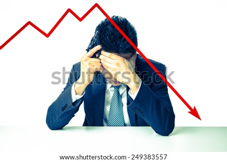 The depressed businessman holding a gun behind bad Stock market chart - stock photo