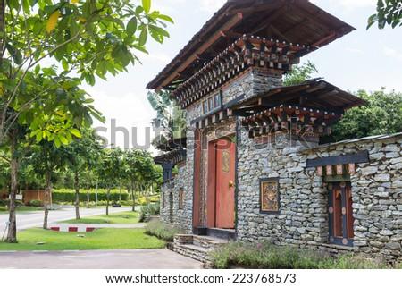 the design of bhutan gateway in the garden - stock photo