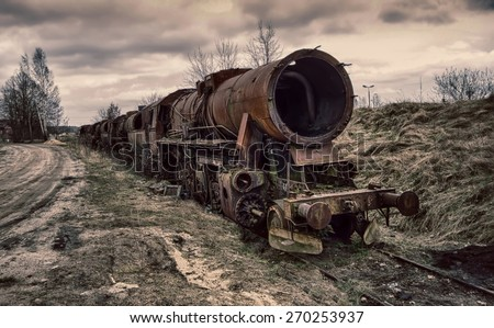 The destroyed old locomotive - stock photo