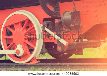 The detail of old red train wheels - stock photo