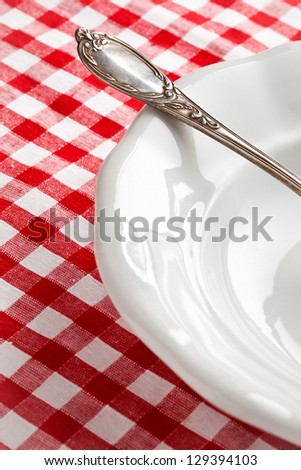 the detail of vintage cutlery on white plate - stock photo