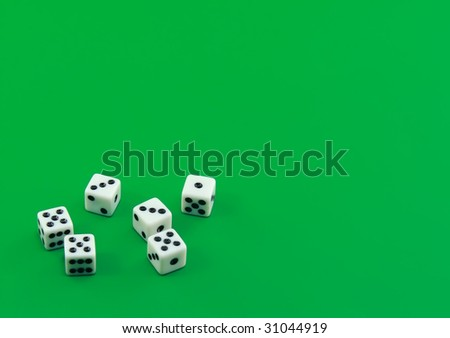 The dice on green background - stock photo