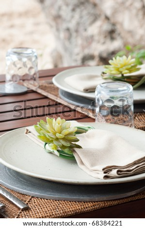 the dining table was decorated with the lotus flower for the romantic time - stock photo