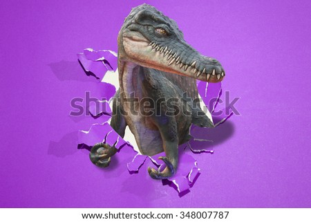 The dinosaur through the paper wall. - stock photo