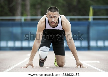 The disabled athlete preparing to start running - stock photo