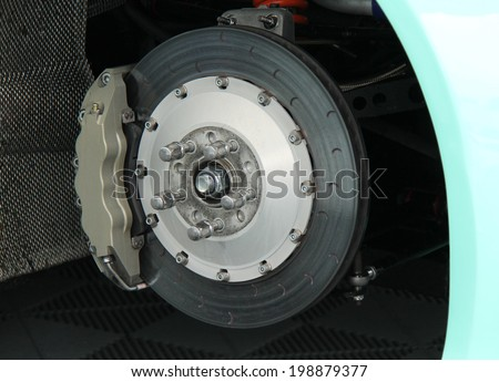 The Disc and Calliper of a Racing Sports Car. - stock photo