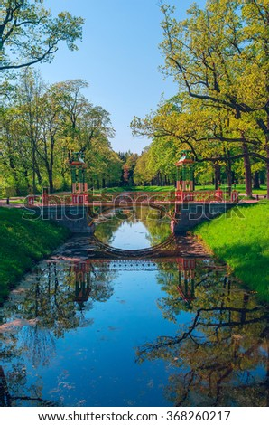 The ditch with a bridge in the park of Pushkin near St. Petersburg on a sunny summer day - stock photo