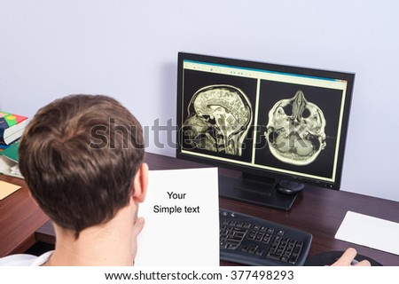 The doctor during the visual inspection the results of the tomography in doctor office / computer tomography / computed tomography - stock photo
