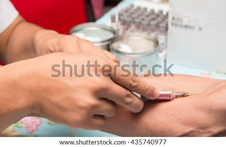 the doctor takes blood on the analysis - stock photo