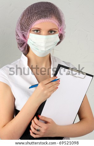 The doctor with a tablet - stock photo